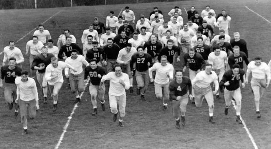 The University of Washington football team starts spring workouts, April 1946. Photo: P-I File