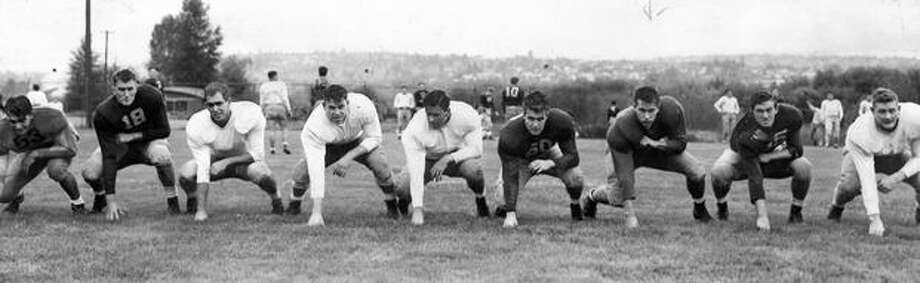 Left to right are Husky players Bob Nelson, Chuck Olson, Hank Melusky, Gail Bruce, Jack Tracey, Dick Hagen, Ernie Stein, Jelly Anderson and Cal Kean. The photo was taken in May, 1947. Photo: P-I File