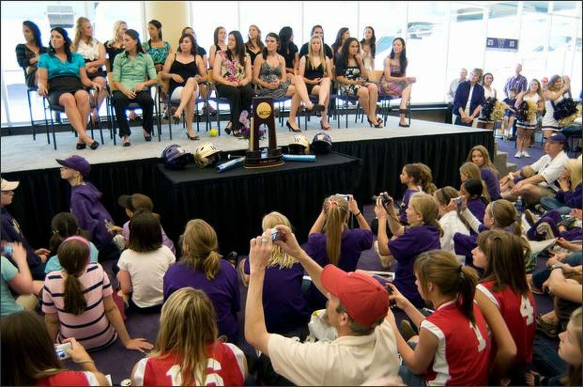 The UW Softball Team takes the stage in a ceremony to celebrate their College World Series championship title, at Husky Stadium Sunday.