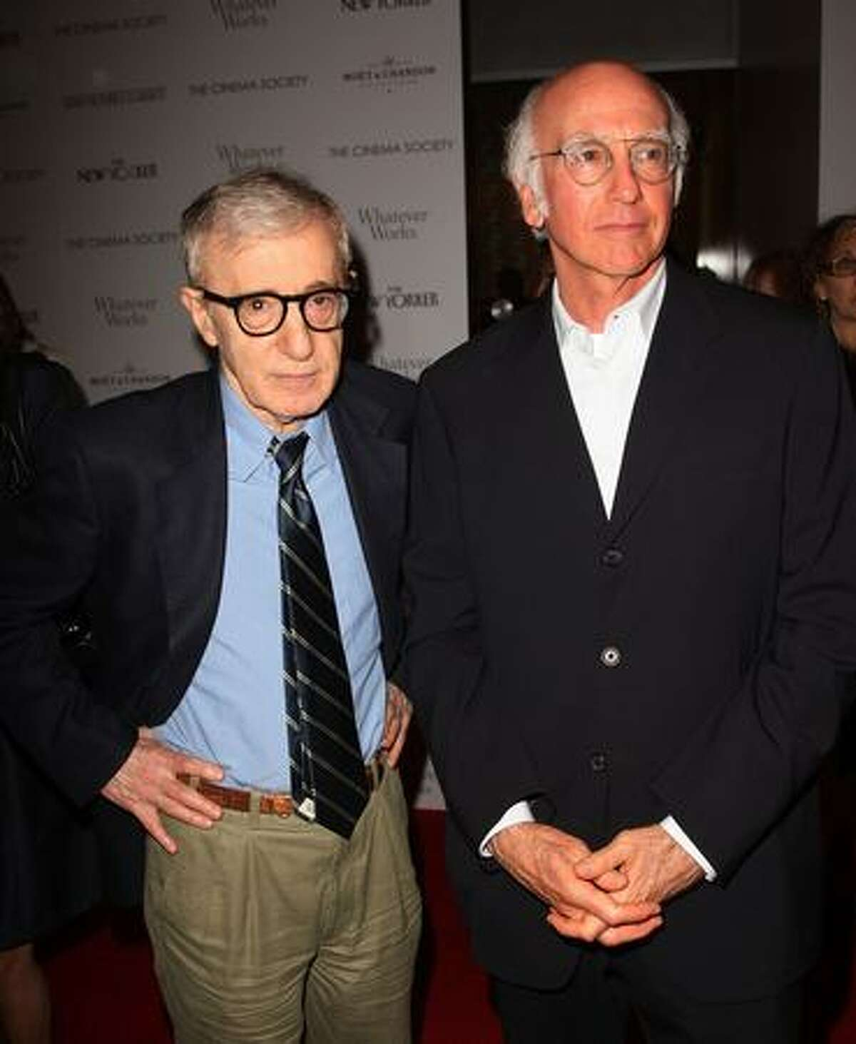 Director Woody Allen (L) and actor Larry David attend a screening of