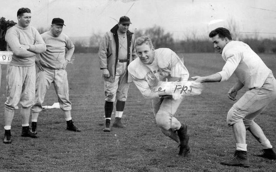 A spring football practice in April 1947. Photo: P-I File