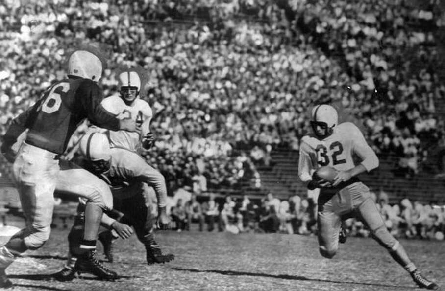 Husky fullback Roland Kerkby in an Oct. 1948 game against Stanford. Anse McCullough (24) is also pic