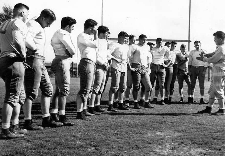 UW coach Max Starcevich during a freshman turnout. There were 76 players in uniform that Sept. 1948 afternoon. Photo: P-I File