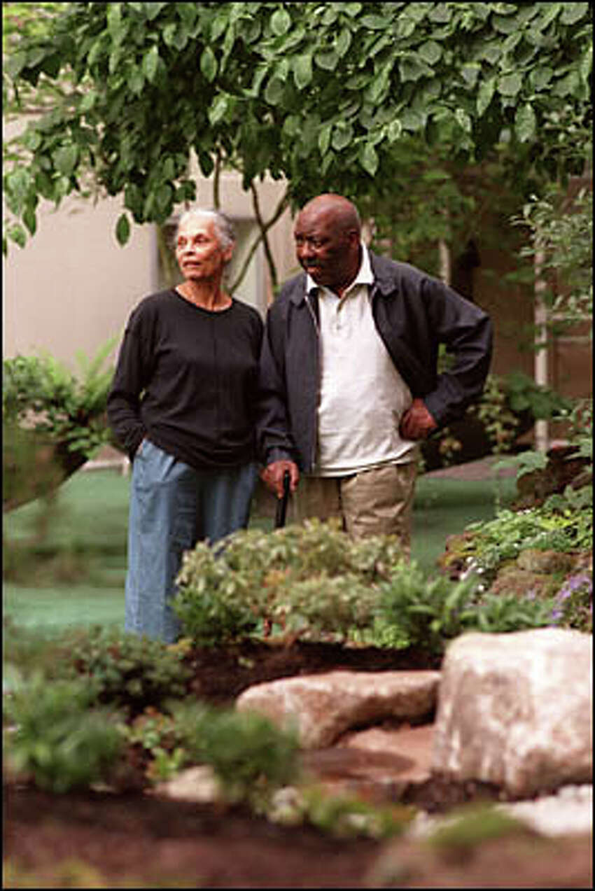 Jacob Lawrence and his wife Gwen Knight saunter through the Horizon House gardens. They married 57 years ago.
