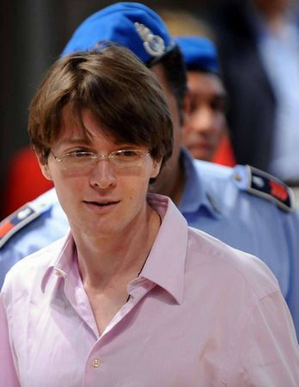 Italian student Raffaele Sollecito, accused of killing with his ex-girlfriend U.S. student Amanda Knox (not pictured), Knox's British housemate Meredith Kercher two-years ago, takes place during his trial on Friday in the courtroom in Perugia. U.S.'s Amanda Knox was testifying during this court session for the first time in her sex-murder trial, with the American accused of taking part in the 2007 killing of her British housemate Meredith Kercher in Italy.