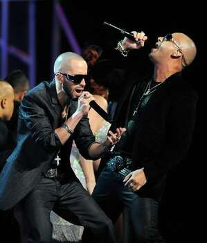 Wisin y Yandel perform onstage. Photo: Getty Images