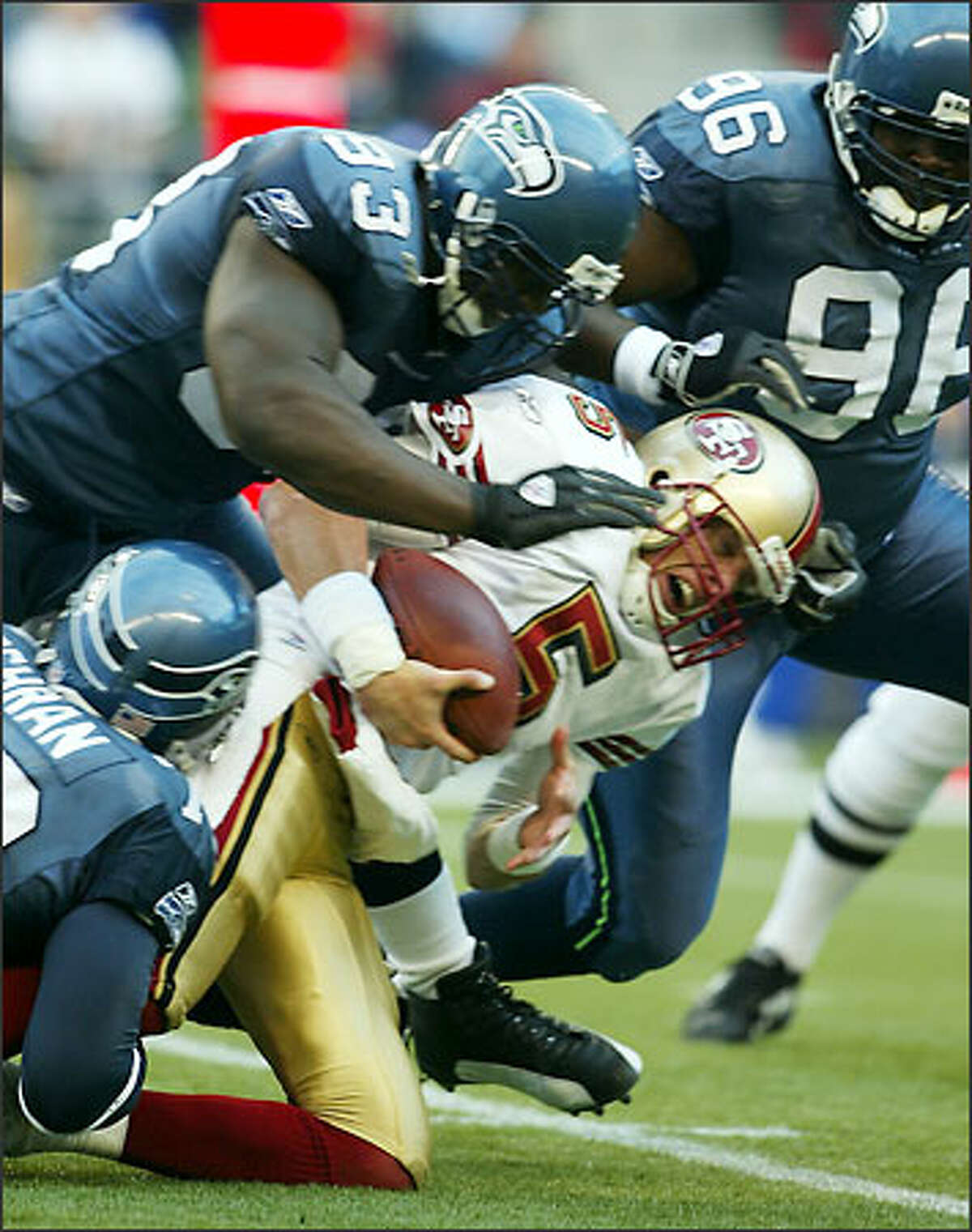 Seahawks' John Randall and Antonio Cochran pull down 49er's Jeff Garcia with 12:53 left in the first quarter of play at Seahawks Stadium Sunday.