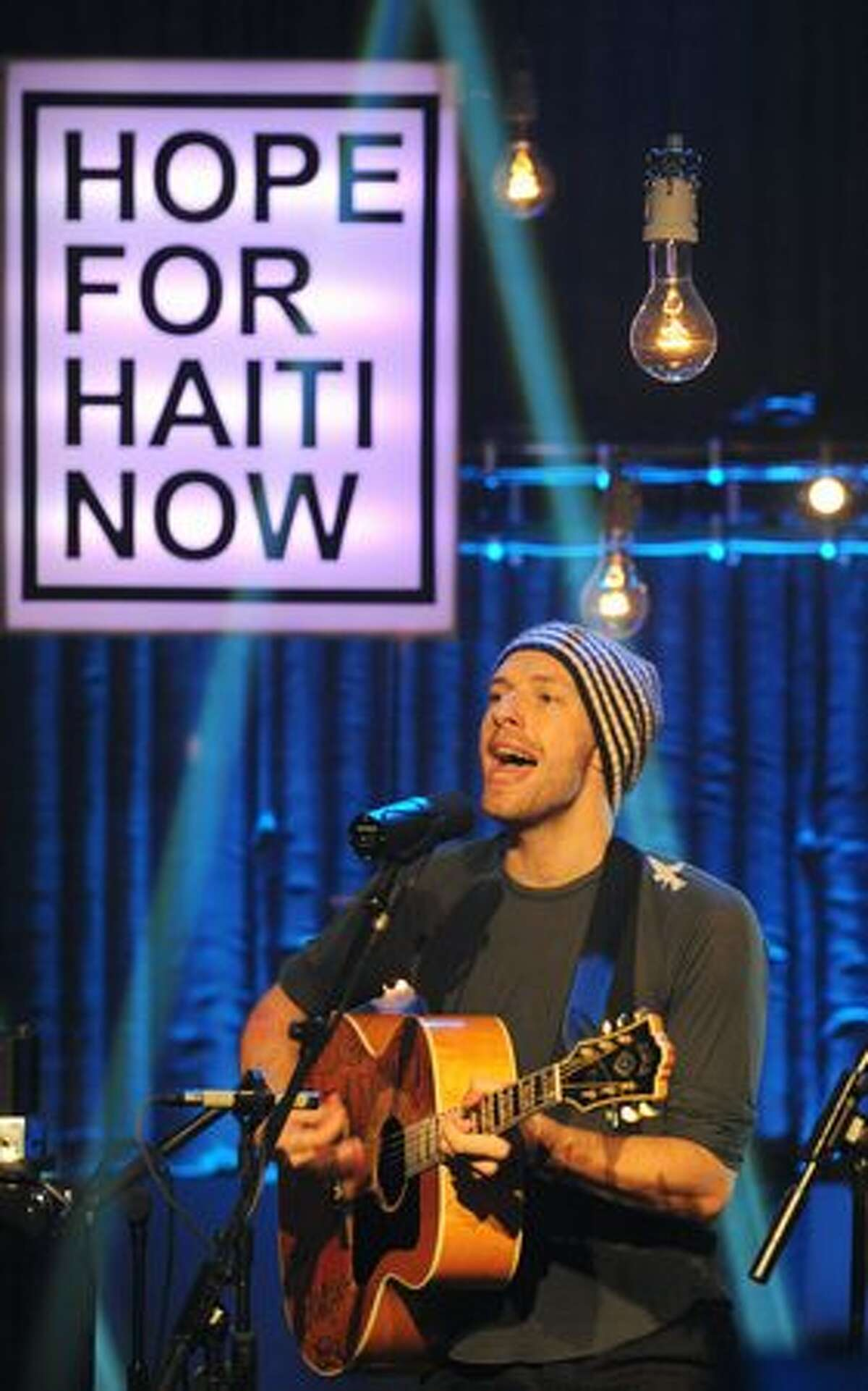 Chris Martin of Coldplay performs on stage at the Hope For Haiti Now concert in London.