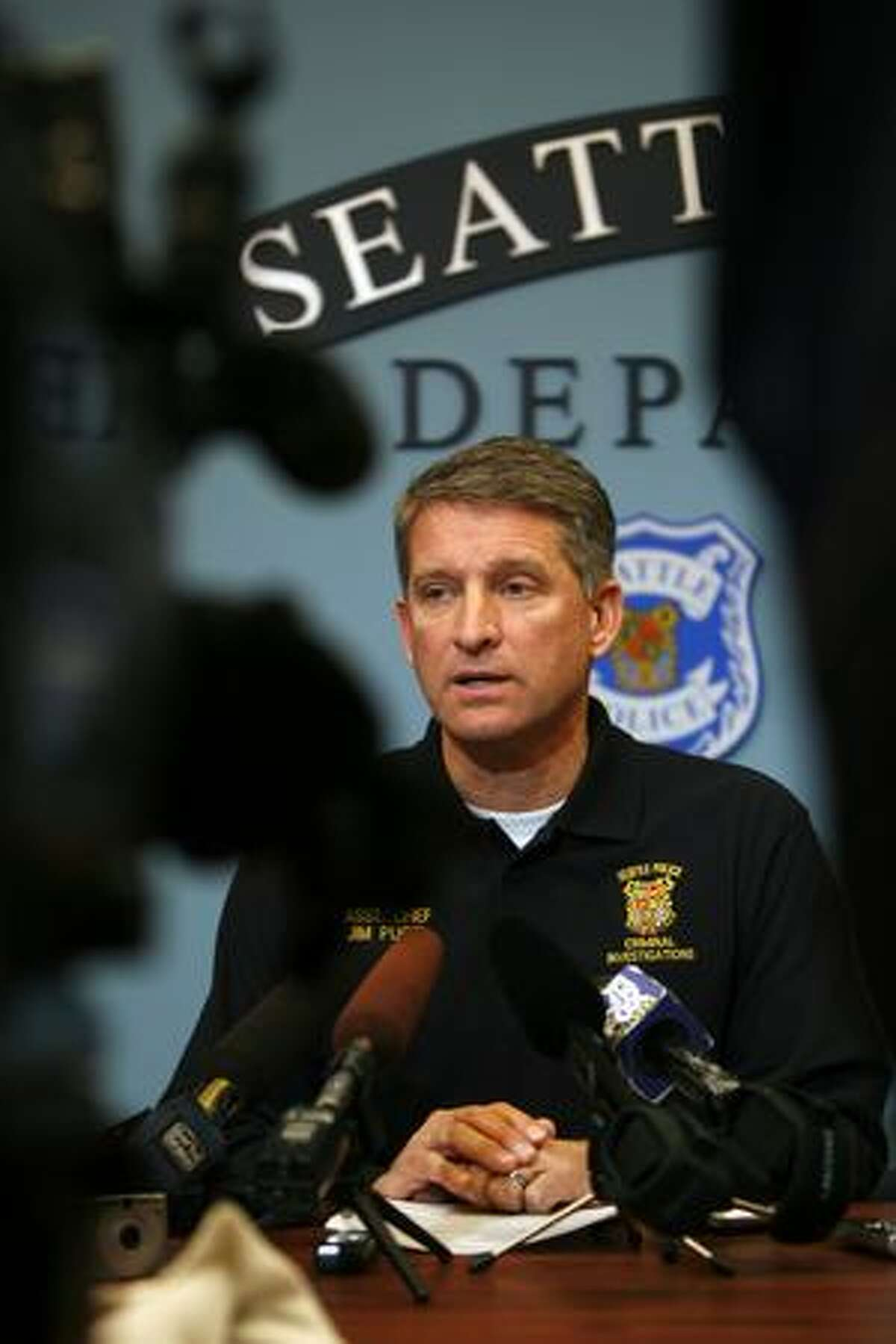Assistant Seattle Police Chief Jim Pugel briefs reporters on developments in the shooting death of Officer Tim Brenton and wounding of Officer Britt Sweeney. The suspect, Christopher J. Monfort, was shot Friday at his Tukwila apartment. Police also linked him to the Oct. 22 arson of four police vehicles. Follow this link to hear audio from the briefing.