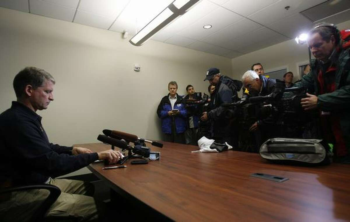 Assistant Seattle Police Chief Jim Pugel prepares to brief reporters on developments in the shooting death of Officer Tim Brenton and wounding of Officer Britt Sweeney. The suspect, Christopher J. Monfort, was shot Friday at his Tukwila apartment. Follow this link to hear audio from the briefing.