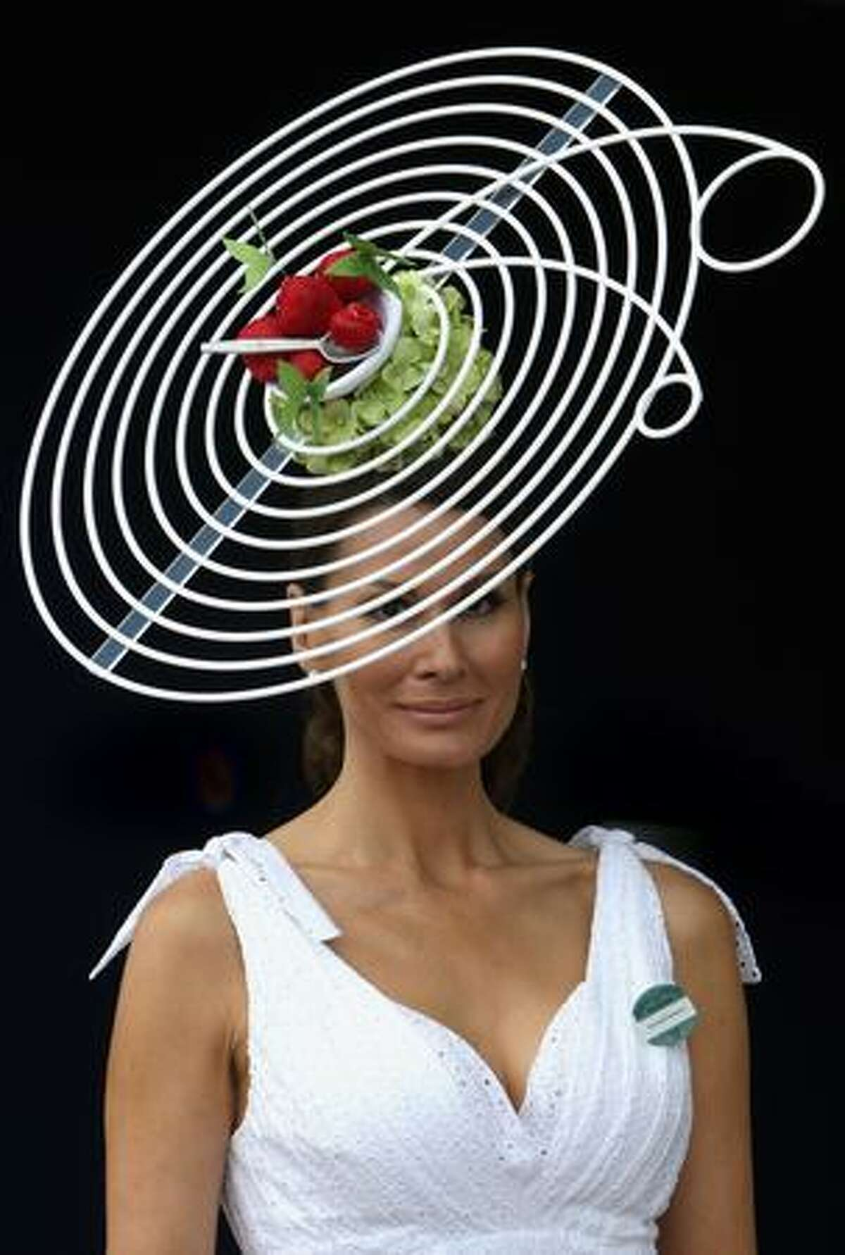 Isabella Christensen poses for a photograph in her hat as she arrives on the first day of Royal Ascot 2009 at Ascot Racecourse in Ascot, England.