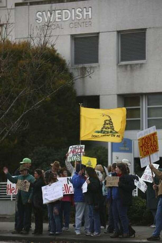 Protestors waited outside Swedish Hospital as Speaker Nancy Pelosi speaks inside about the health care bill. Photo: Braden VanDragt, Seattlepi.com