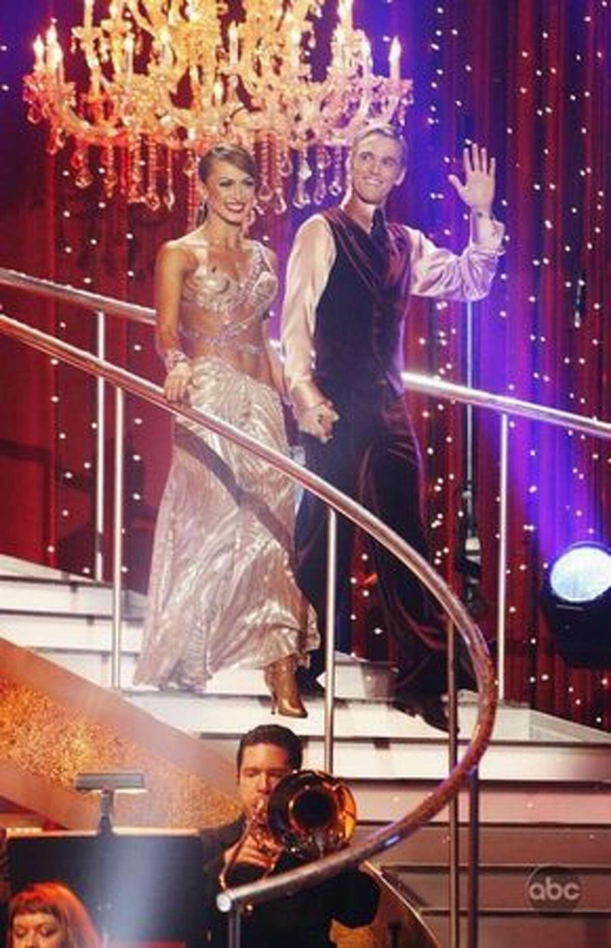 Professional dancer Karina Smirnoff and singer Aaron Carter are introduced.