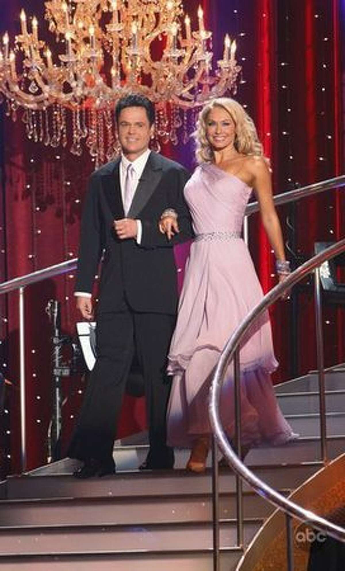 Singer Donny Osmond and professional dancer Kym Johnson are introduced.