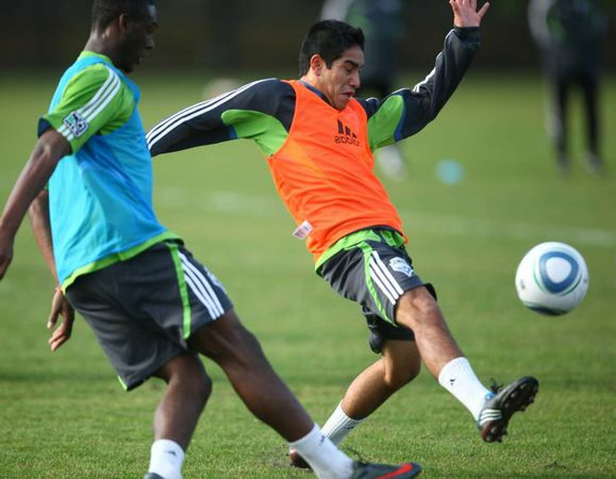 Seattle Sounders draft pick David Estrada drills with the Sounders during the first day of training camp on Monday at Starfire Sports Complex in Tukwila.