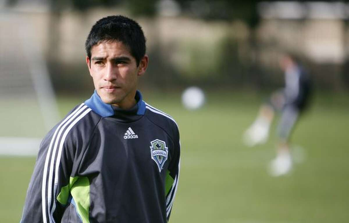 Seattle Sounders draft pick David Estrada stands on the sidelines during the first day of training camp on Monday at Starfire Sports Complex in Tukwila.