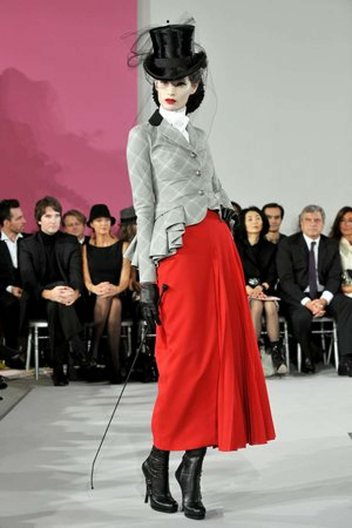 A model walks the runway in Christian Dior.