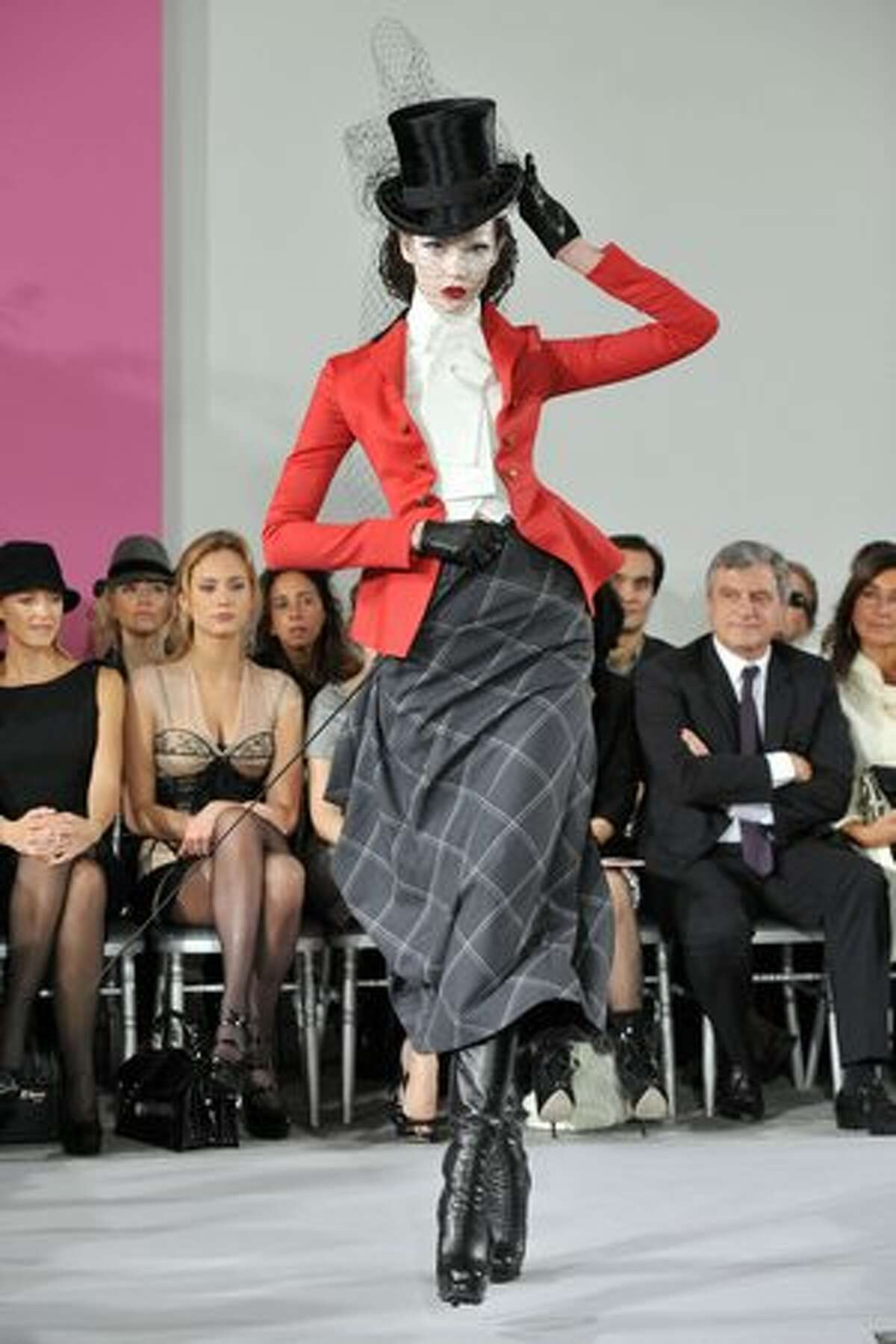A model walks the runway at the Christian Dior haute couture show as part of Paris Fashion Week spring/summer 2010 at Boutique Dior in Paris on Monday, Jan. 25, 2010.