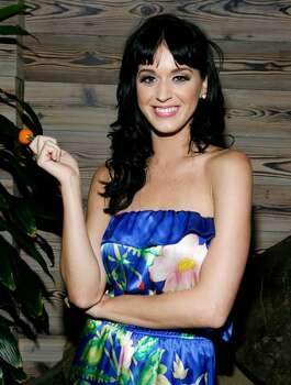 Katy Perry holding a Sugar Factory Couture Lollipop attends a post concert party at The Griffin on July 28, 2009 in New York. Photo: Getty Images