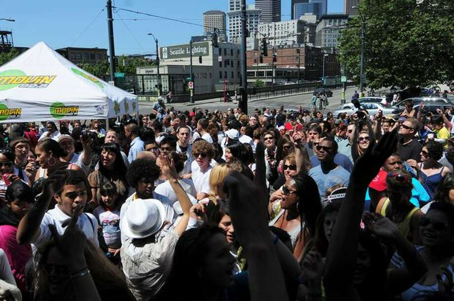 Hundreds gathered outside of Union Station on Sunday to do the Michael Jackson moonwalk as part of a radio tribute to the late singer. Photo: Daniel Berman, Seattlepi.com