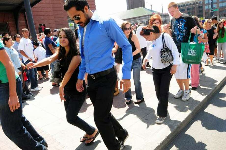 People attempt to do the moonwalk. Photo: Daniel Berman, Seattlepi.com