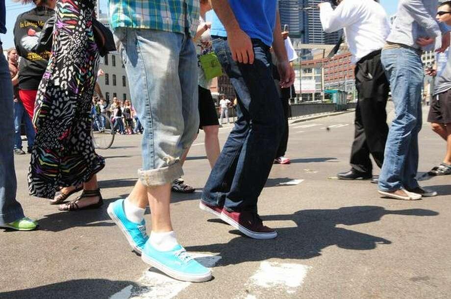People attempt to do the moonwalk. Photo: Daniel Berman, Seattlepi.com