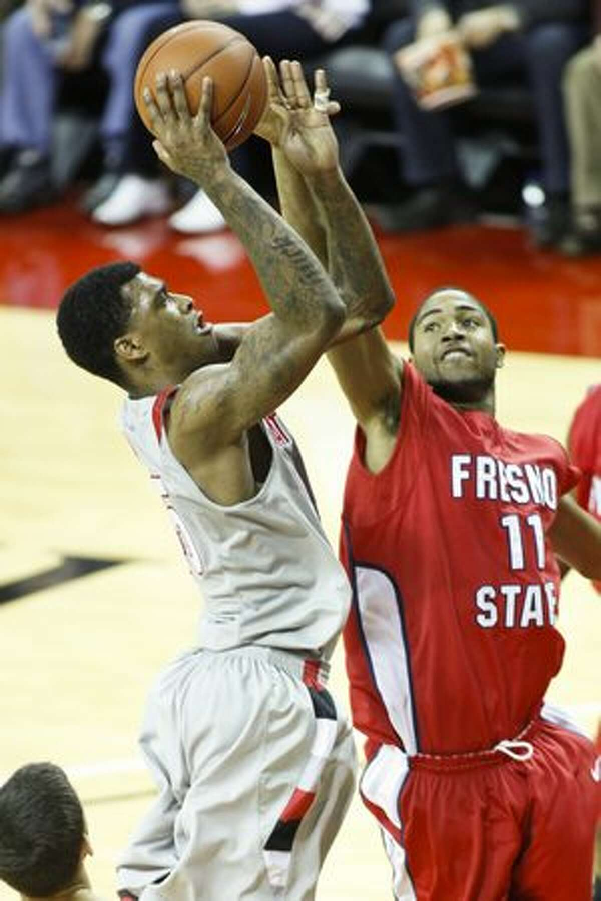 Charles Garcia shoots against Fresno State's Jerry Brown III.