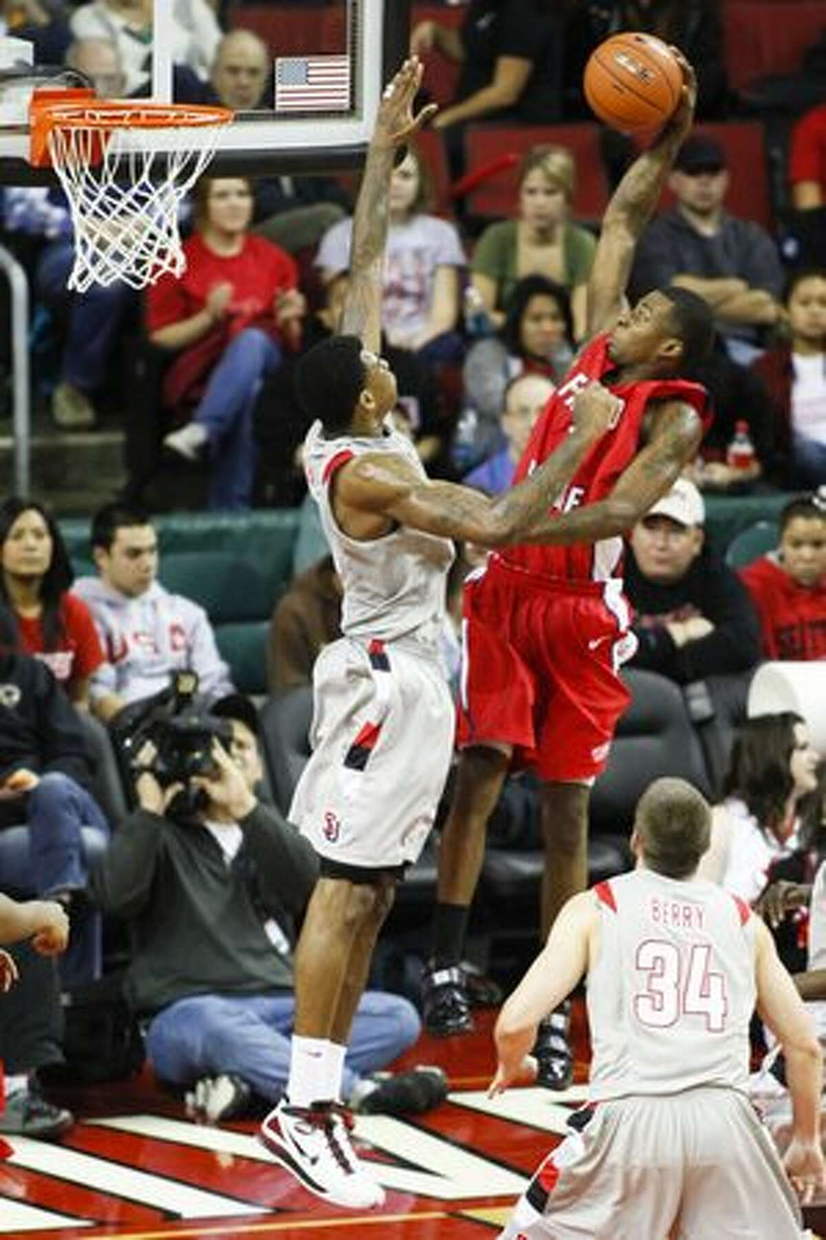 Charles Garcia blocks a shot from Fresno State. The Redhawks won the home opener 85-84 in the final seconds.