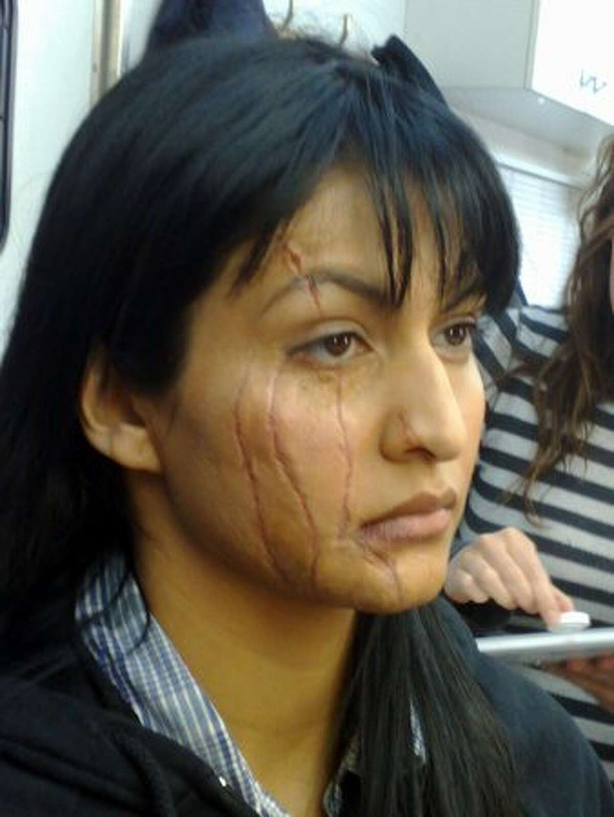 A woman wears makeup created by character effects company Masters FX created for