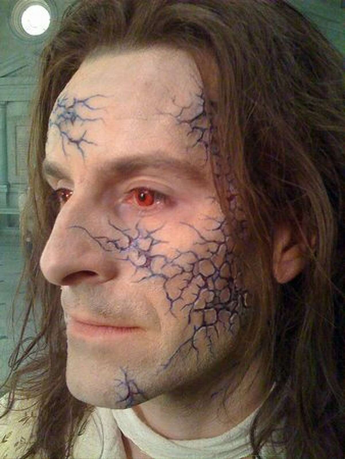 A man wears makeup character effects company Masters FX created for