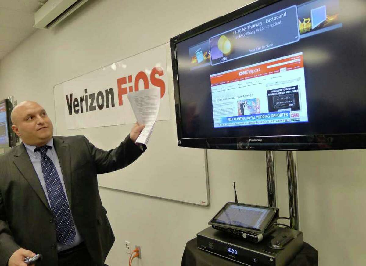 Alfred C. Vasso,Jr.,Verizon Northeast Region Group Marketing Manager, shows off some of the features of Fios service durng a press conference in Colonie March 25, 2011.( Michael P. Farrell/Times Union )
