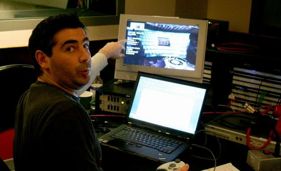 """Lead producer Oren Stambouli shows off his workspace during Tuesday's live production of """"1 vs. 100."""" Photo: Nick Eaton, Seattlepi.com"""
