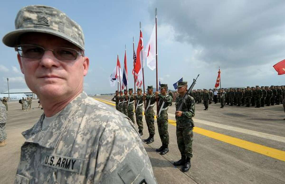 A member of the U.S. Army stands guard during the opening ceremony of the annual combined military exercise Cobra Gold 2010 at U-Tapao airport in Rayong province, Thailand, on Feb. 1, 2010.