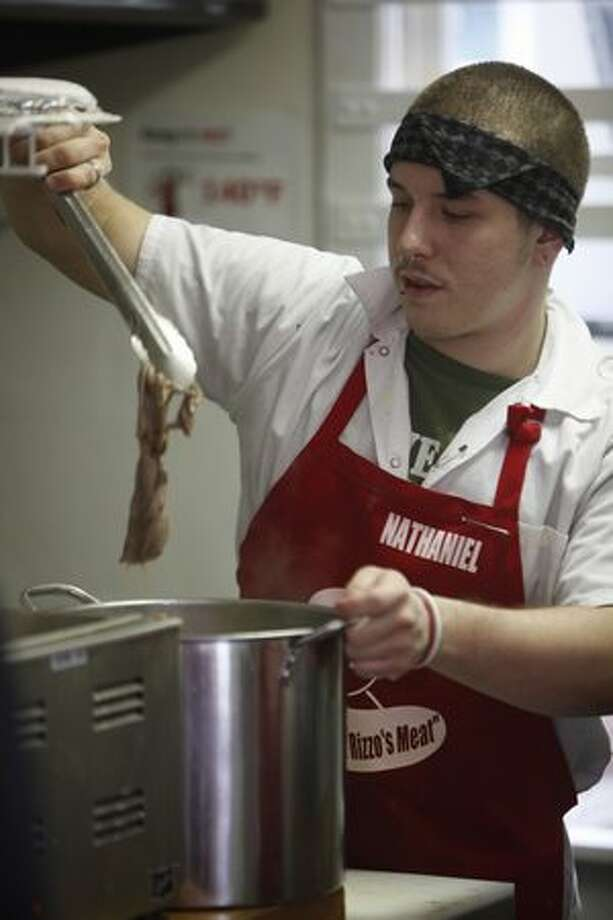 Nathan Grier prepares meat for french dips. Grier had been homeless since he was 17 until 10 months ago when Rizzo hired him to do odd jobs. He has since found a place to live and has worked as a cook at Rizzo's French Dip since it opened five months ago. Photo: Braden VanDragt, Seattlepi.com