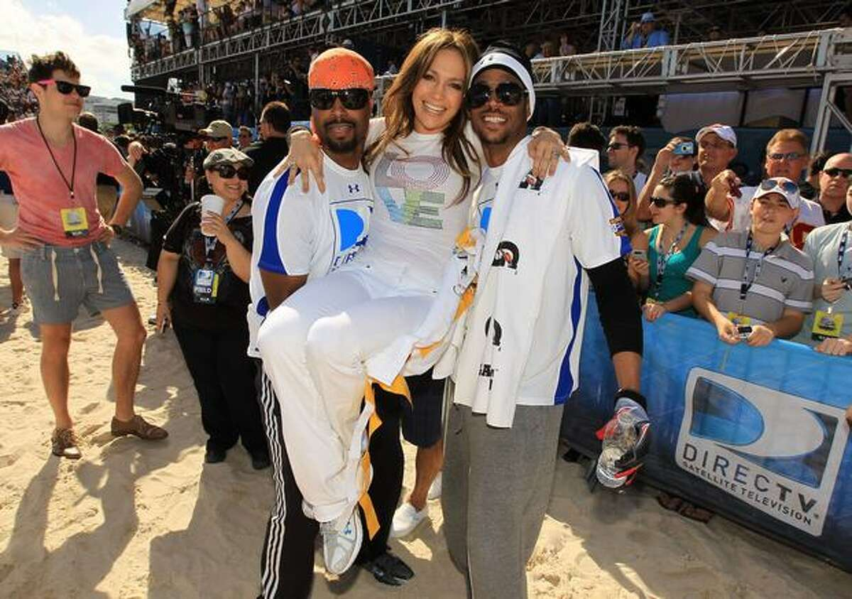 Singer Jennifer Lopez (center) with Shawn Wayans and Marlon Wayans attend the Fourth Annual DIRECTV Celebrity Beach Bowl at DIRECTV Celebrity Beach Bowl Stadium: South Beach on February 6, 2010 in Miami Beach, Florida.