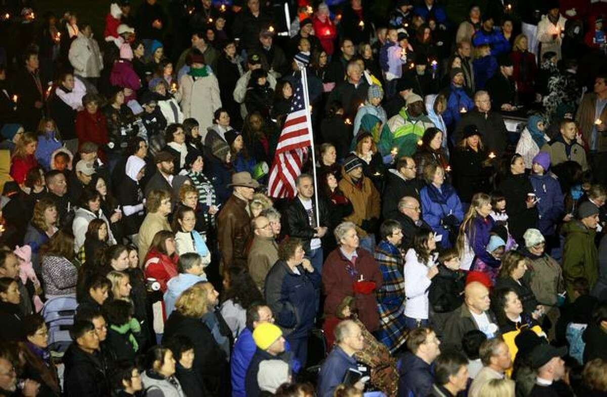 A crowd of thousands gather during a candlelight vigil on Wednesday December 2, 2009 at the Lakewood Family YMCA in Lakewood, Wash. The large crowd gathered to pay their respects to the four Lakewood Police officers who were shot and killed at a coffe shop Sunday morning in nearby Parkwood.