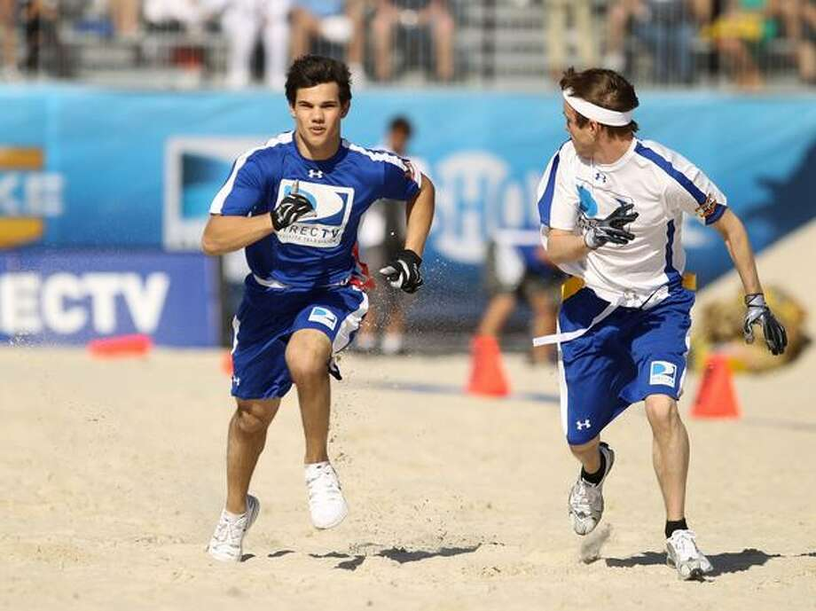 We're betting Lautner has to exercise pretty hard to keep himself in shirtless shape. This photo was taken at DIRECTV's 4th Annual Celebrity Beach Bowl on Feb. 6, 2010 in Miami Beach, Fla. Go, Taylor, go. Run like a wolf. (Getty Images) Photo: Getty Images
