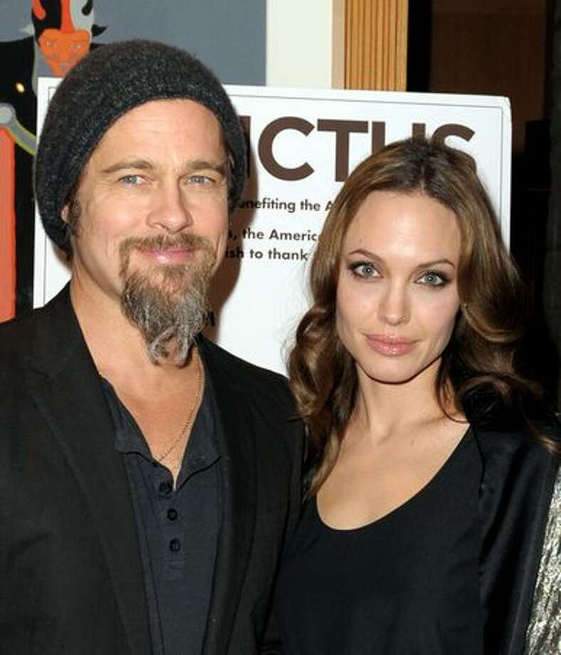 "Actors Brad Pitt (L) and Angelina Jolie arrive at the premiere of Warner Bros. Pictures' and Spyglass Entertainment's ""Invictus"" at the Academy of Motion Picture Arts and Sciences Theater in Beverly Hills, California. Photo: Getty Images"