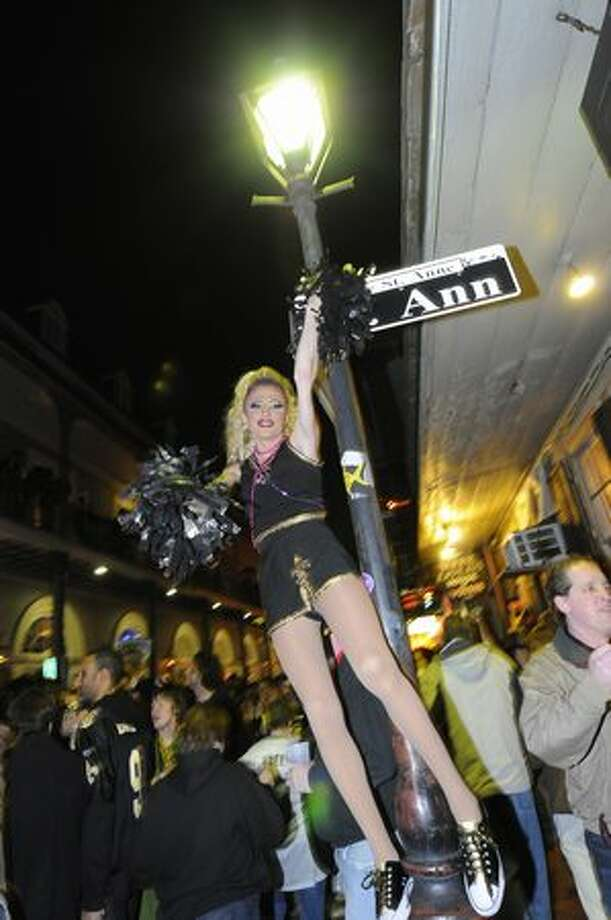 Fans celebrate the New Orleans Saints win against the Indianapolis Colts on Bourbon Street in the French Quarter. Photo: Getty Images
