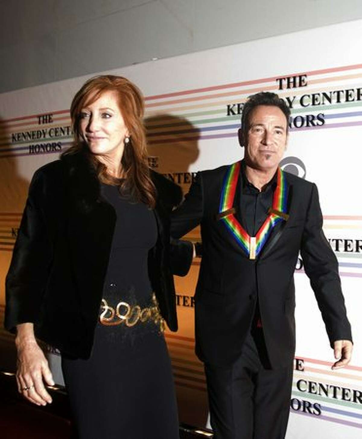 Patti Scialfa and Bruce Springsteen pose for photos on the red carpet.