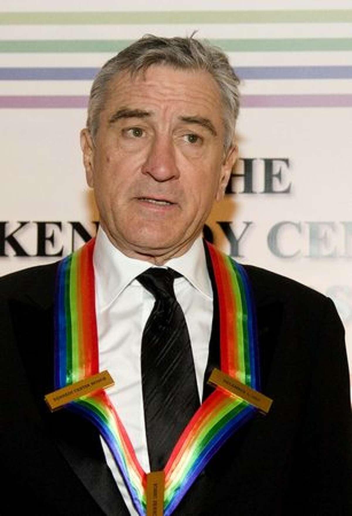 Robert De Niro poses for photos on the red carpet.