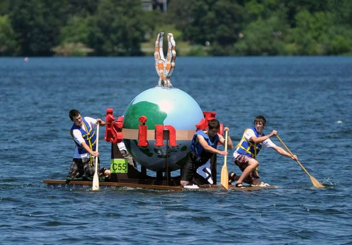 Historic Seattle's P-I globe boat races in Seattle's Seafair Milk Carton Derby on Green Lake Saturday.