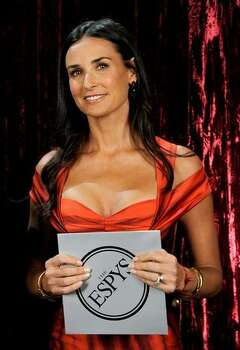 Actress Demi Moore poses backstage. Photo: Getty Images