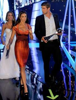 Actress Demi Moore and Olympic swimmer Michael Phelps, recipient of the Best Male Athlete, walk backstage. Photo: Getty Images