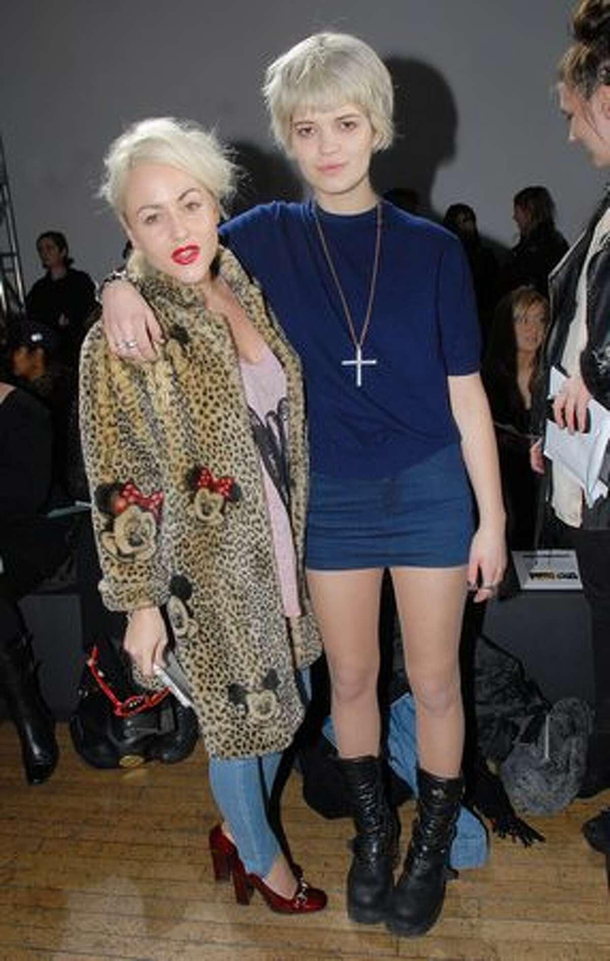 Jaime Winstone (L) and Pixie Geldof attend the Felder & Felder catwalk show as part of London Fashion Week in London, England.