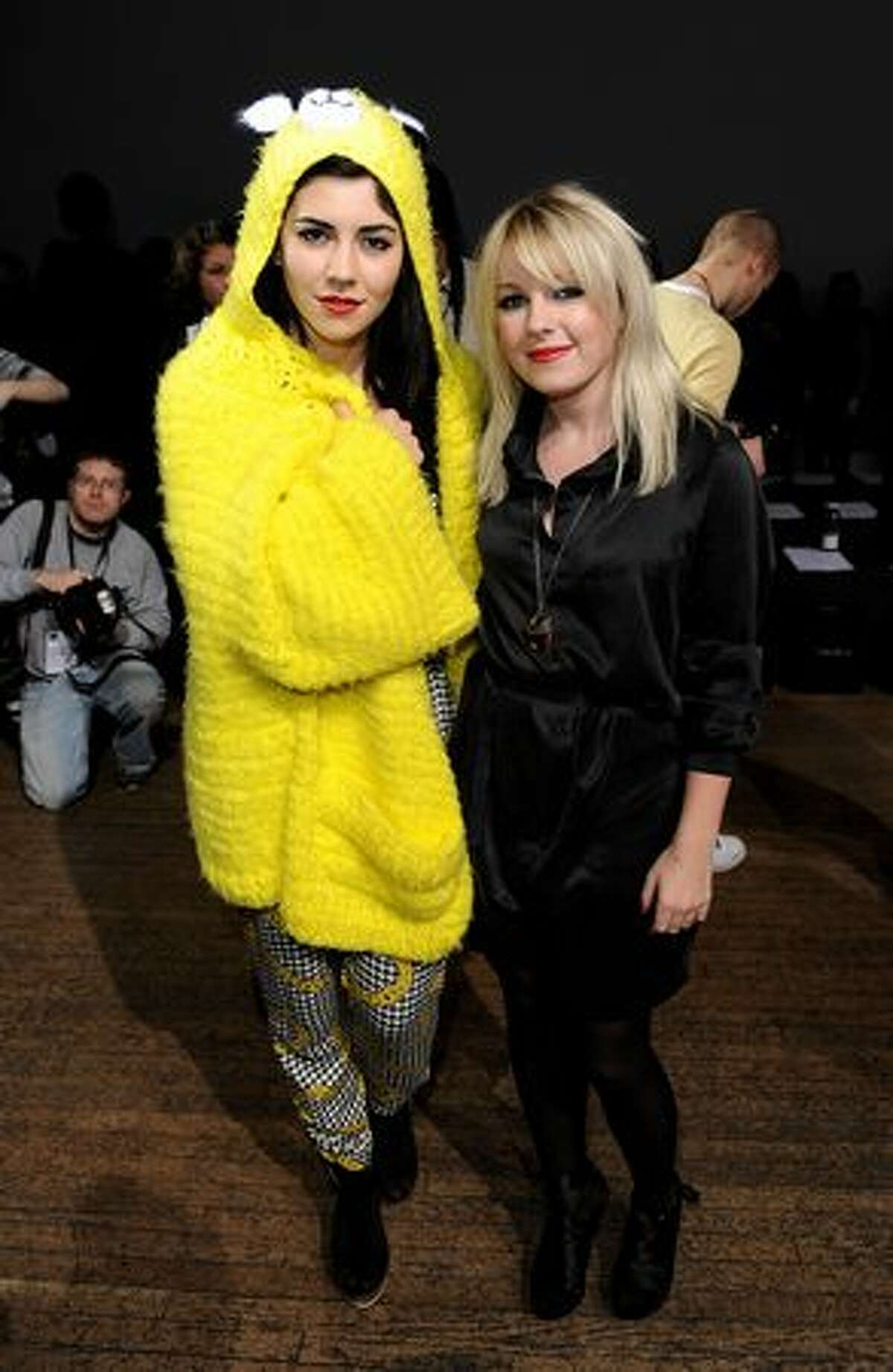 (L-R) Marina Diamandis and Little Boots attend the House of Holland fashion show during London Fashion Week in London, England.