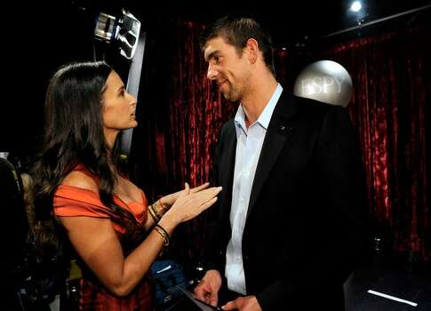 Actress Demi Moore (left) and Olympic swimmer Michael Phelps, recipient of the Best Male Athlete, speak backstage. Photo: Getty Images