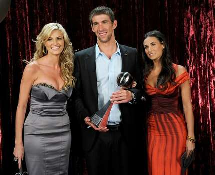 ESPN reporter Erin Andrews, Olympic swimmer Michael Phelps, recipient of the Best Male Athlete, and actress Demi Moore pose backstage. Photo: Getty Images