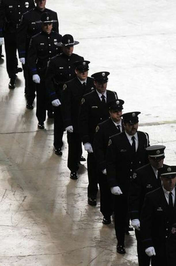 Officers march into the Tacoma Dome during the memorial service for four slain Lakewood police officers. Photo: Daniel Berman, Seattlepi.com