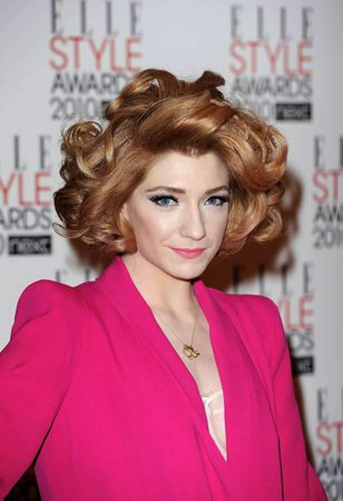 Nicola Roberts arrives.